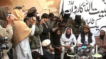Hafiz Saeed Khan (third from the right) is shown in Orakzai Agency in 2009, when he was a TTP commander. He was killed in Afghanistan in July. He is seated next to then-TTP chief Hakimullah Mehsud (dark vest), who was killed in 2013. [Zahir Shah]