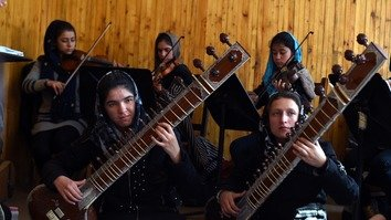 Afghan music students rehearse January 8 in Kabul. The group is set to be catapulted onto the world stage at the World Economic Forum in Davos, Switzerland, January 19-20. [WAKIL KOHSAR/AFP]