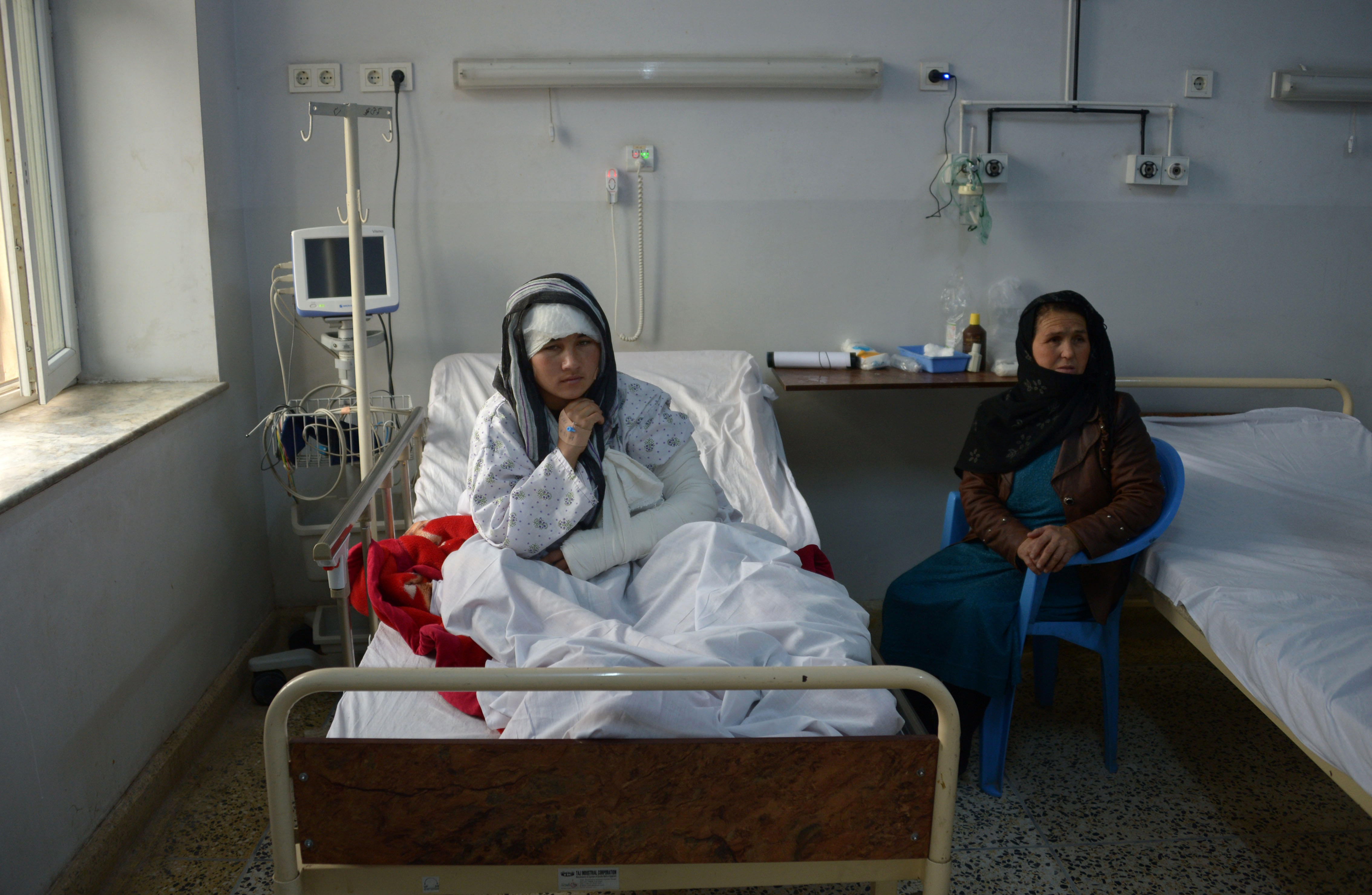 Afghan woman maimed by husband seeks justice, treatment abroad