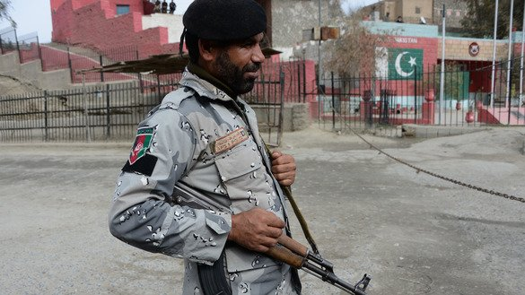 An Afghan border police officer guards the Torkham border crossing between Afghanistan and Pakistan February 17. After a suicide bombing at a Sufi shrine in Sehwan, Pakistan, on February 16 killed 80 people and injured more than 200, Pakistani authorities closed the main border crossing between Afghanistan and Pakistan for an indefinite period. [Noorullah Shirzada/AFP]
