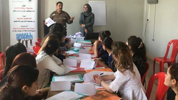Yazidi women who escaped the 'Islamic State of Iraq and the Levant' receive small business training in Shariya camp in Dohuk province. [Photo courtesy of Public Aid Organisation's Facebook page]