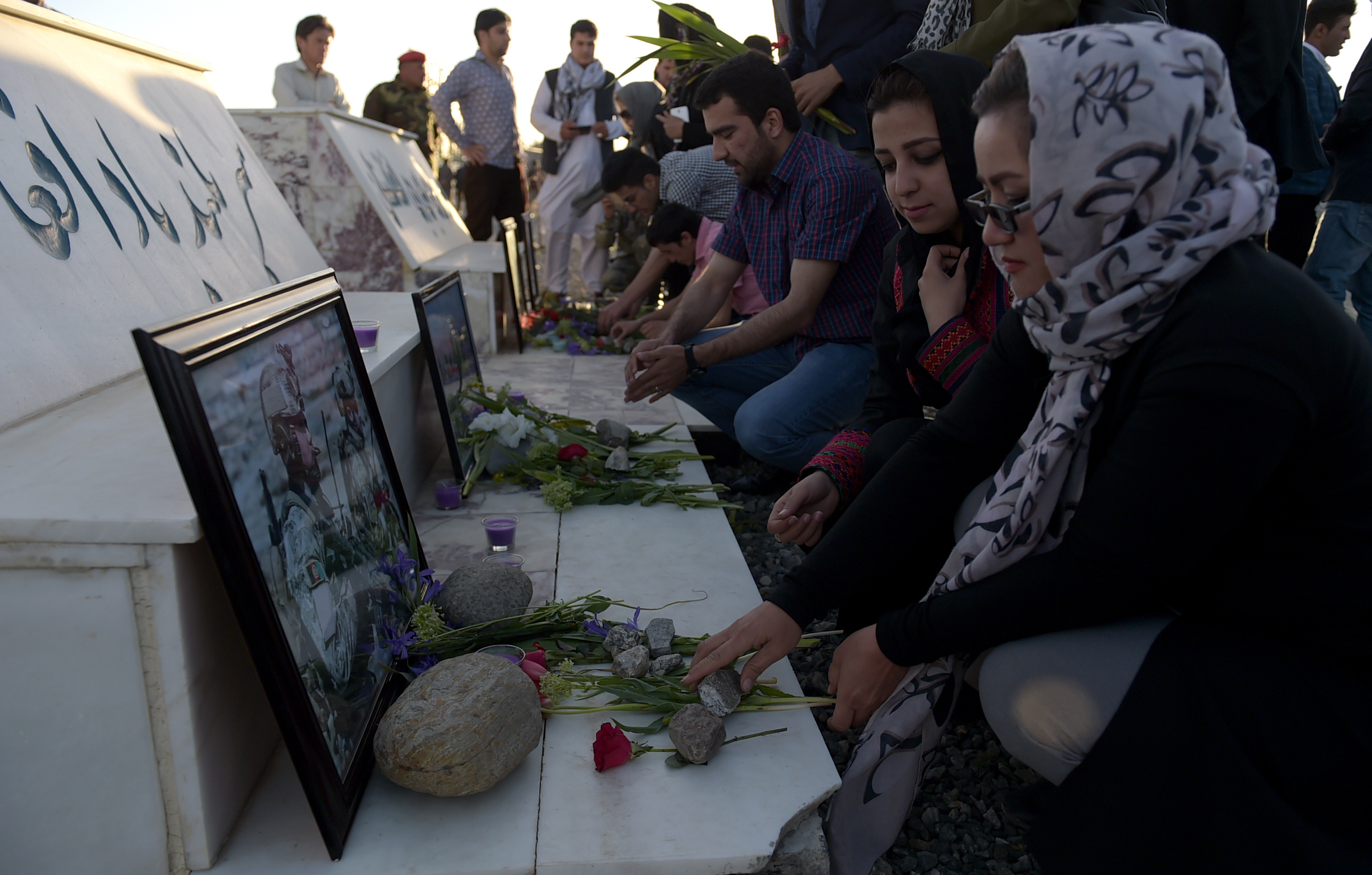 Afghans furious after Taliban base attack; top officials resign