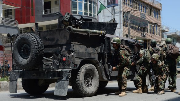 Afghan security forces take up a position at the site of a Jalalabad suicide bombing May 17. At least six people were killed in the terrorist attack. [Noorullah Shirzada/AFP]