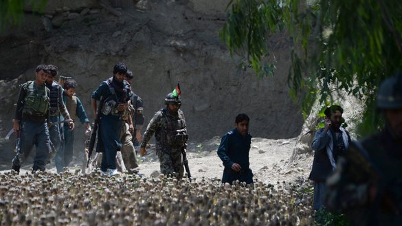 Afghan security forces patrol during an anti-'Islamic State of Iraq and Syria' (ISIS) operation in Chaparhar District, Nangarhar Province, May 21. Troops have killed at least 70 ISIS members in recent operations, say security officials. [Noorullah Shirzada/AFP]