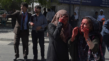 Wounded Afghans gesture at the site of a massive truck bombing in Kabul May 31. At least 80 people were killed when the blast ripped through Kabul's diplomatic quarter. [Shah Marai/AFP]