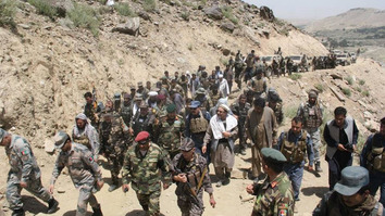 Afghan troops June 19 march through Tora Bora after driving out 'Islamic State of Iraq and Syria' (ISIS) militants. [Courtesy of Nangarhar provincial government press office]