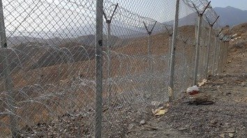 Recently erected fencing along the Pakistani-Afghan border is shown in a photo released June 20. Pakistan is fencing off 'high infiltration prone' areas to prevent cross-border militant movements and to improve regional security. [ISPR]
