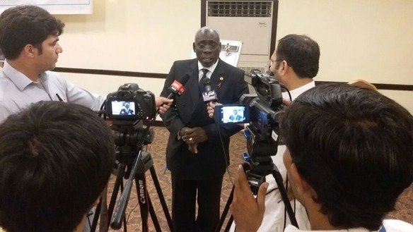 UNAIDS Country Director for Pakistan and Afghanistan Dr. Mamadou L. Sakho talks to media in Peshawar July 11. [Ashfaq Yusufzai]