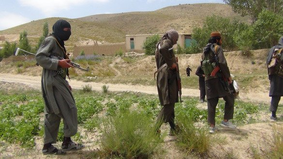 Fighters with Afghanistan's Taliban militia walk with their weapons in Ahmad Aba district on the outskirts of Gardez, the capital of Paktia province, on July 18, 2017. Observers say the Taliban is the main reason for the spread of HIV/AIDS in Afghanistan due to the militant group's regular attacks on health clinics and facilities. [Faridullah Ahmadzai/AFP]