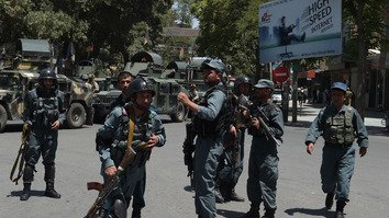 Afghan troops arrive at the site of a suicide bombing targeting the Iraqi embassy in Kabul July 31. [Shah Marai/AFP]