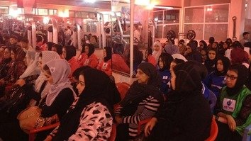 Women listen to the owner of the Faryab women-only fitness centre during its opening-day ceremonies July 3. [Ziar]