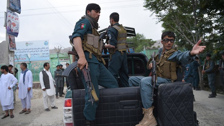 Afghan police officers June 3 in Kabul arrive at the site of explosions that targeted a funeral. Civilians increasingly rely on the 119 hotline to report security incidents, crimes and suspicious activities, officials say. [Wakil Kohsar/AFP]