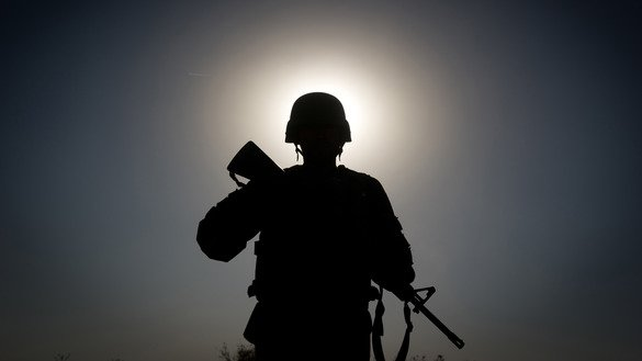 An Afghan National Army soldier patrols around Ahmed Khan camp near Kandahar city. [Martin Bureau/AFP]