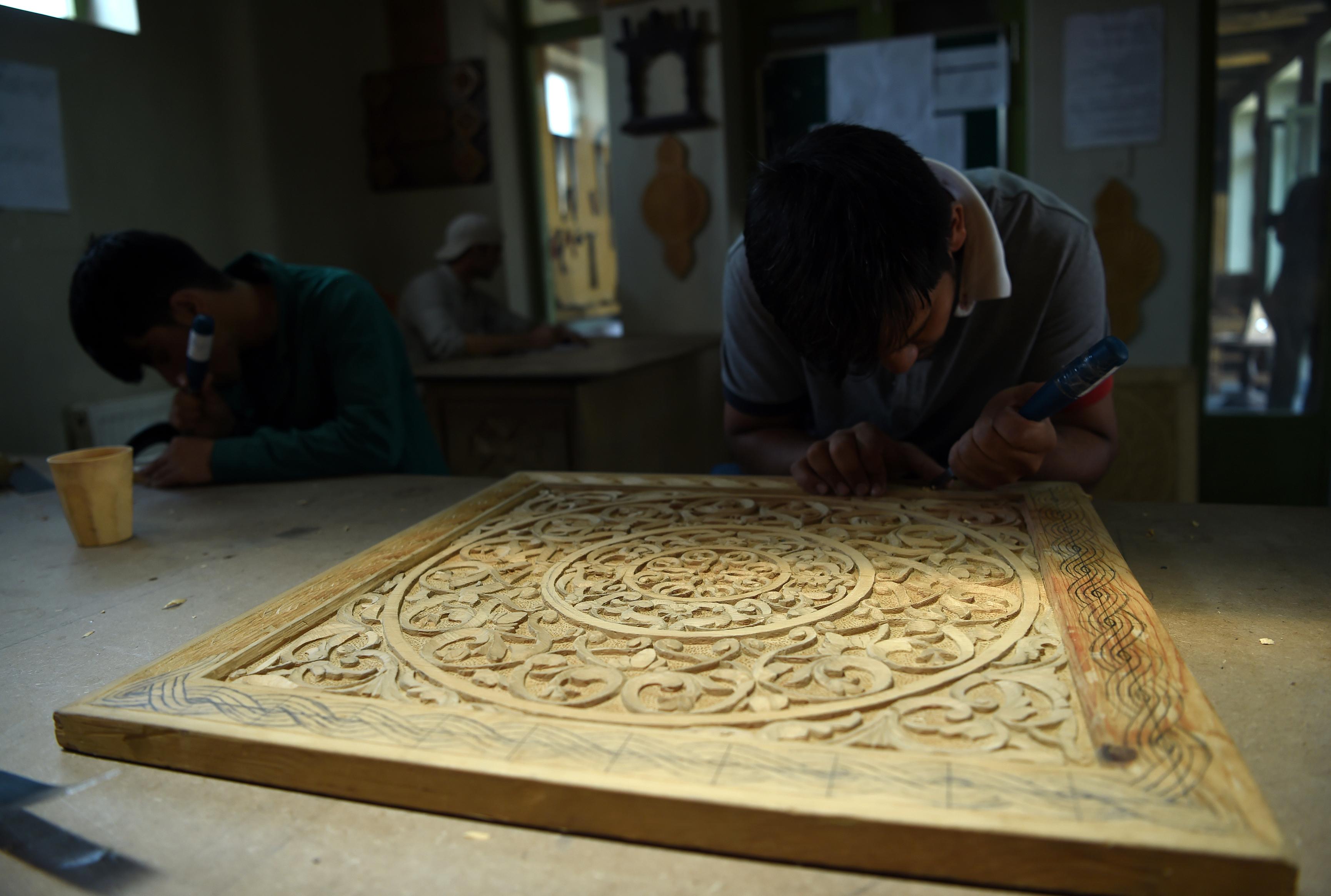 در تصاویر: نجات صنعتگران افغانستان از خطر انقراض