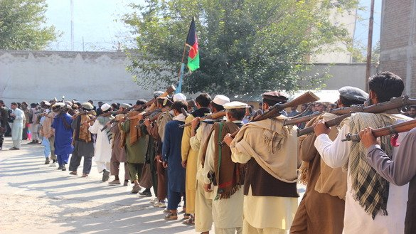 Taliban insurgents November 1 in Asadabad wait in line to surrender their weapons to authorities. [Khalid Zerai]