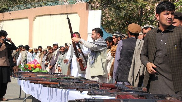 Taliban insurgents November 1 in Asadabad surrender their weapons. [Khalid Zerai]