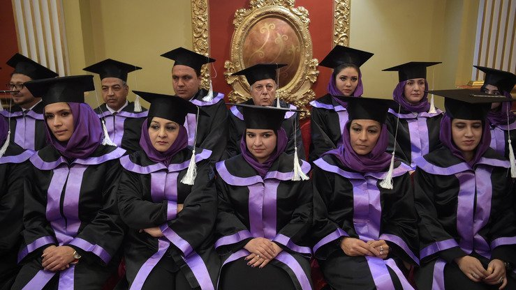 Fifteen women and seven men graduated from the two-year master's programme in women's studies, a course that would have been unthinkable during the Taliban's repressive 1996-2001 rule. [Shah Marai/AFP]
