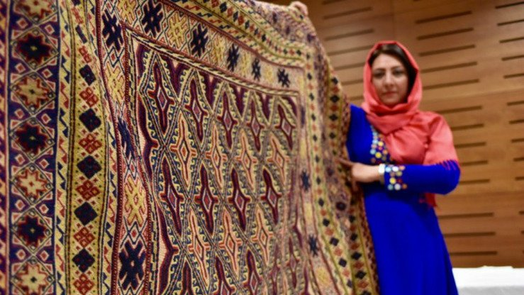 An Afghan businesswomen displays her goods at a fair in Kabul. [USAID/Afghanistan]
