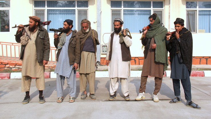 A picture taken on December 3 shows six militants before they handed over their arms to authorities in Jalalabad, Nangarhar Province. A seventh member of the group who feared for his life refused to be photographed. [Khalid Zerai]