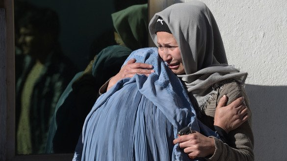 Women weep for their relatives at a hospital following an ISIS attack on a Shia community centre in Kabul December 28. At least 40 people were killed and dozens more wounded in multiple blasts. [Shah Marai/AFP]