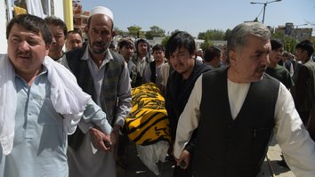 Mourners last August 27 carry the coffin of one of the 28 victims of an ISIS-claimed suicide attack on a Shia mosque a day earlier in Kabul. [Shah Marai/AFP]