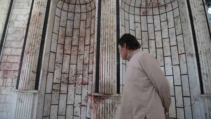In this photograph taken on October 23, 2017 an Afghan resident looks on inside the Imam Zaman Shiite mosque after a ISIS suicide attack claimed 56 lives. Iran has been accused of supporting ISIS activities in Afghanistan. [Shah Marai/AFP]