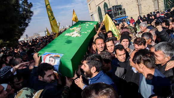 A picture taken December 15 in Karaj, Iran, shows the funeral of Seyed Ali Naghavi, a suspected Afghan member of the Fatemiyoun Brigade who lost his life in the Syrian war. Iranian authorities never reveal the identity of fallen combatants when they are Afghans. [Aref Fathiakbari/Mehr News Agency]