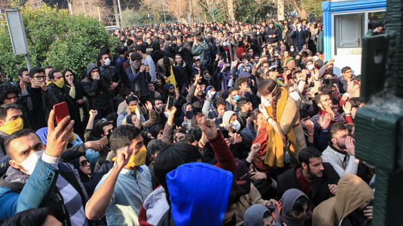 Iranian students protest at the University of Tehran December 30 during a demonstration driven by anger over economic problems. [STR/AFP]