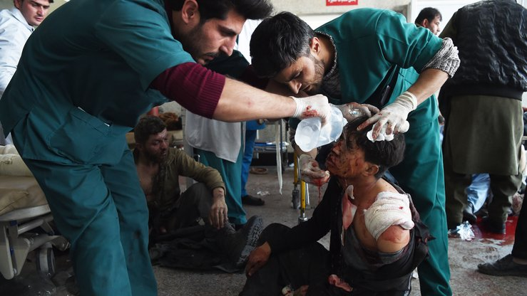 Afghan medical staff treat a wounded man at Jamhuriat Hospital in Kabul on January 27 after an ambulance packed with explosives blew up in a crowded local area, killing at least 103 people, officials said. [Wakil Kohsar/AFP]