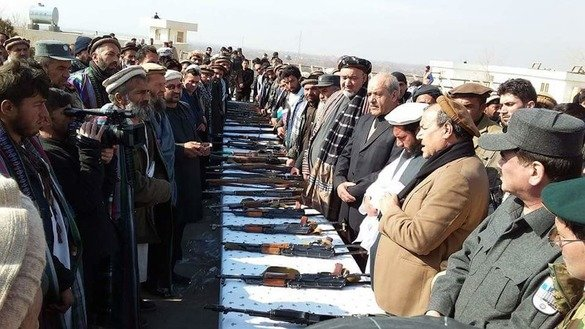 Former Taliban militants in Kapisa Province turn in their weapons during a ceremony on January 22, 2018. [Media Office of Kapisa Provincial Governor]