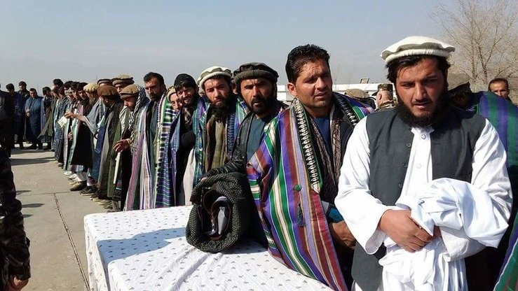 A group of 56 former Taliban insurgents turn in their weapons January 22 and pledge to fight alongside government forces. [Kapisa governor's press office]