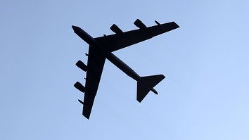 A US Air Force B-52 flies over Arlington, Virginia, August 14, 2015. Coalition forces are using B-52s to pound insurgents in Afghanistan. [Mark Wilson/Getty Images/AFP]