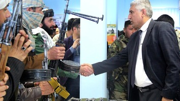 Herat Provincial Governor Mohammad Asif Rahimi greets former Taliban insurgents February 21 in Herat city. [Sulaiman]