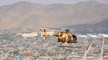 A helicopter flies over Kabul during a coalition training mission in 2016. The Afghan government is beefing up security in Kabul after a series of terrorist attacks. [US Air Force photo by Capt. Jason Smith]