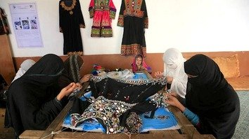 Afghan women in Nangarhar Province learn sewing and embroidery March 6. [Khalid Zerai]