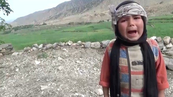 A screenshot of the ISIS video released March 4 shows a distraught Afghan child. ISIS attempts to blame the coalition for killing civilians in the Afghan conflict, yet a series of bloody ISIS terrorist attacks against Afghans in recent months suggests otherwise.