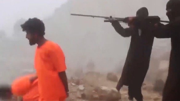A screenshot from an ISIS video released March 4 shows ISIS terrorists gunning down defenceless civilians.