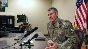 Gen. John Nicholson, who leads US and NATO forces in Afghanistan, speaks to reporters at Bagram Airfield March 14. [Thomas Watkins/AFP]