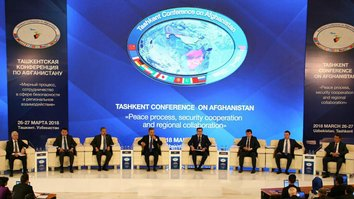 Uzbekistani officials discuss co-operation during a panel session in Tashkent March 24. [Conference press office]
