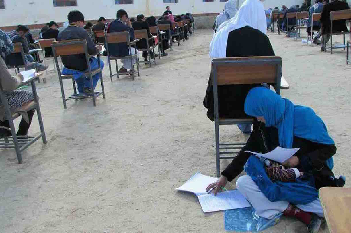 Afghan mom cradling baby during entrance exam inspires youth, women