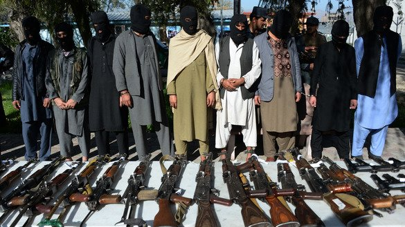 Alleged militants from the Taliban and other groups stand handcuffed while being presented to the media at a police headquarters in Jalalabad, Nangarhar Province, March 6. Faced with continual air and ground raids from Afghan and US forces and mounting political pressure, the Taliban have no option but to join the peace process, observers say. [Noorullah Shirzada/AFP]