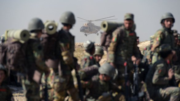 Afghan National Army commandos watch an Mi-17 helicopter at Kabul Military Training Centre last October 17. The Taliban have realised they cannot win on the battlefield and have abandoned previous red lines they set to impede peace talks, say observers. [Shah Marai/AFP]