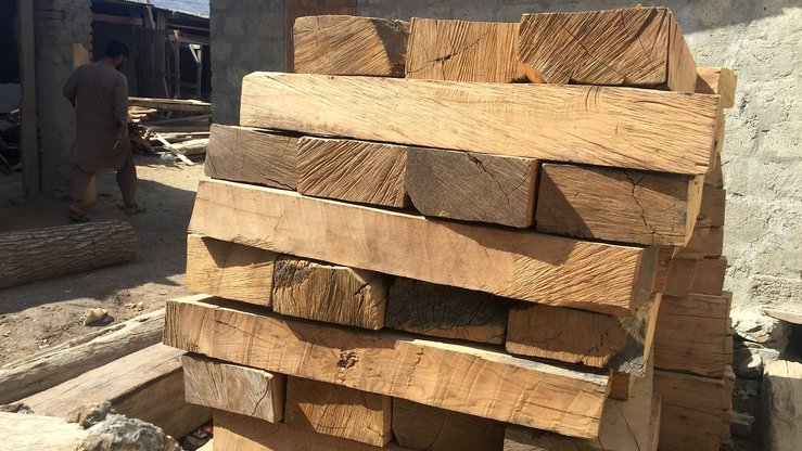 Lumber is stacked outside a building in Asadabad, Kunar Province, October 14, 2017. Taliban and ISIS members have been illegally felling trees in the province to generate funds. Now ISIS and Lashkar-e-Islam (LI) are doing the same in parts of Nangarhar Province. [Khalid Zerai]
