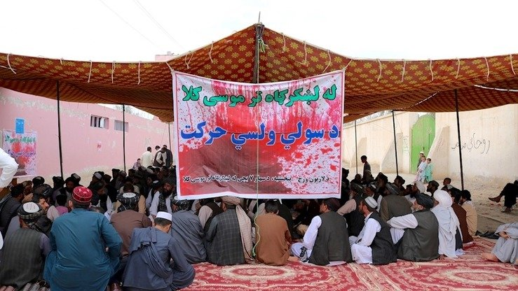 "The sit-in that Lashkargah youth launched March 24 to urge the Taliban to stop killing civilians, pictured here on April 5, is continuing to spread to other parts of Afghanistan. The banner reads, ""From Lashkargah to Musa Qala. People's Peace Movement."" [Sifatullah Zahidi]"