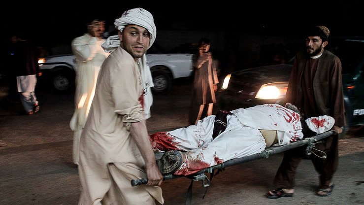Afghan men carry a wounded man into a hospital following a car bomb in Lashkargah, Helmand Province, March 23. The blast spurred a grass-roots demonstration for peace, which has since spread from Lashkargah to other areas of Helmand, as well as to Kandahar, Zabul, Uruzgan, Farah, Bamiyan, Balkh and Nangarhar provinces. [Noor Mohammad/AFP]