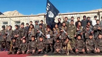 A screenshot from from an ISIS video released March 4 shows dozens of children, many of them forcibly recruited and brainwashed, armed and brandishing ISIS's flag. [File]