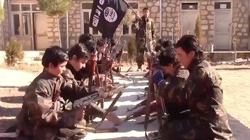 Children undergo arms training in an ISIS video posted March 4. [File]