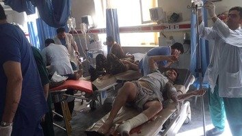 Wounded victims of twin ISIS suicide blasts on April 30 receive treatment at a hospital in Kabul. [Afghanistan Journalists Centre]
