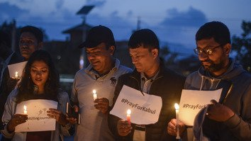 Nepalese media workers May 2 hold a candlelight vigil in Kathmandu condemning the killing of journalists in Afghanistan. Afghanistan's slain journalists were remembered on World Press Freedom Day (May 3), three days after the deadliest attack on the country's media since the fall of the Taliban in 2001. [Bikash Karki/AFP]