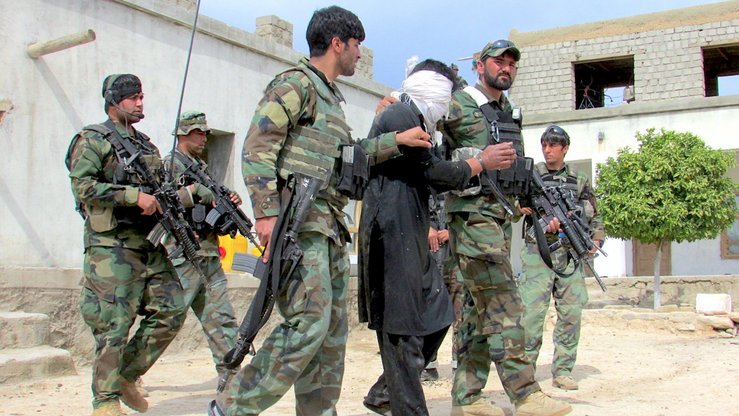 Afghan security forces transport a militant captured in Alishang District of Laghman Province April 30. [Khalid Zerai]